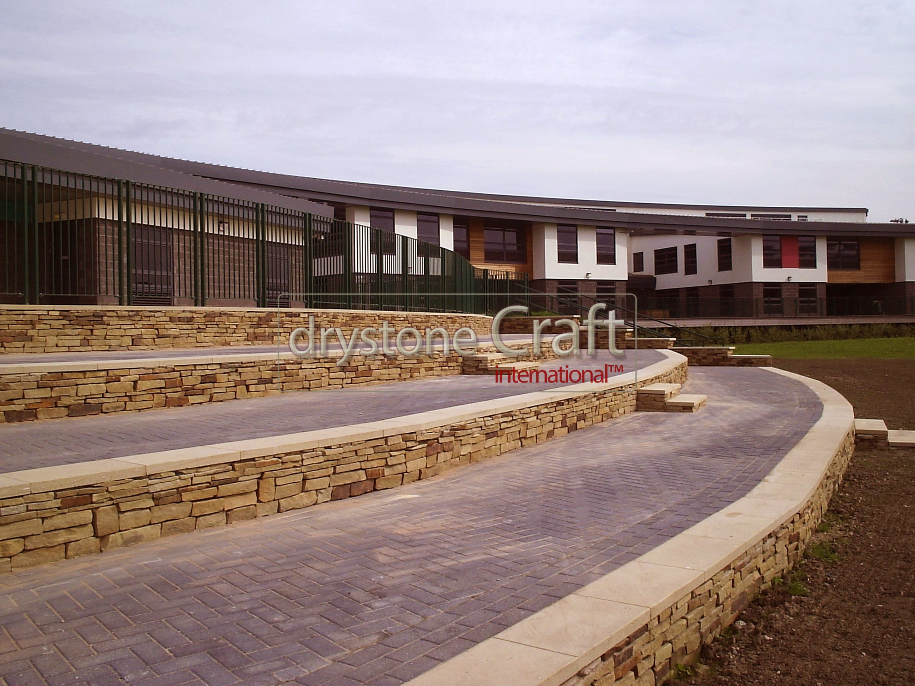 Stone clad retaining walls with stone flag tops unity college burnley