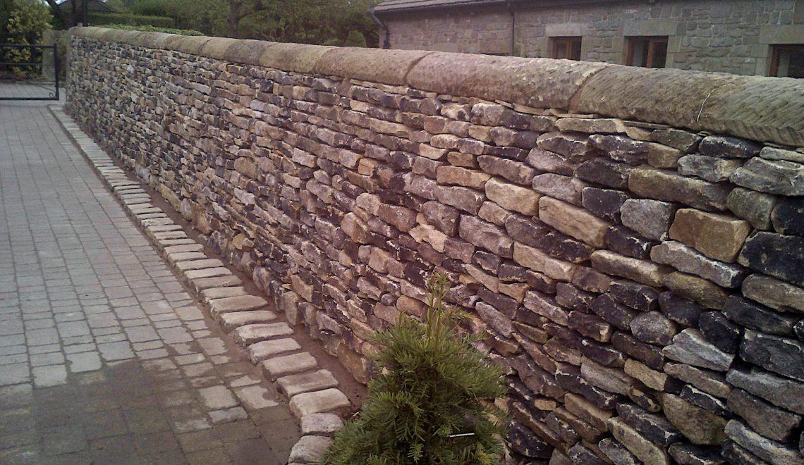 Dry stone boundary wall gritstone