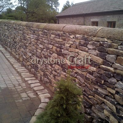 Dry stone boundary wall gritstone